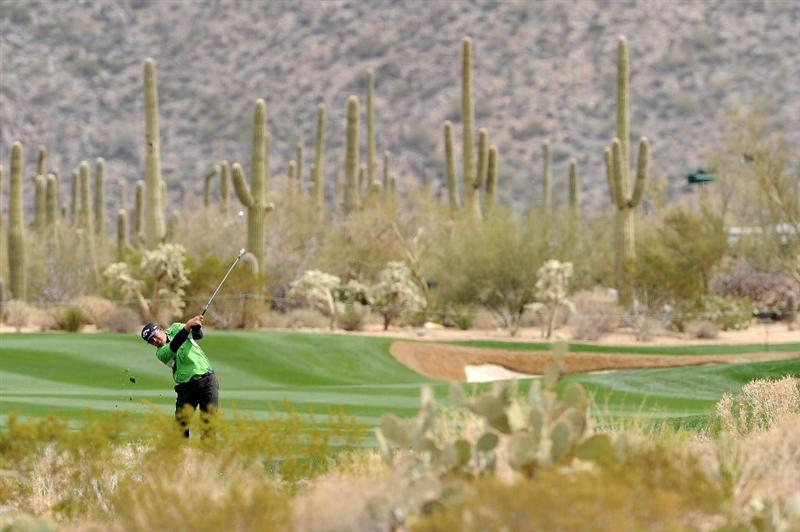 MARANA, AZ - FEBRUARY 26:  J.B. Holmes plays an approach shot from the 18th fairway whilst playing the first playoff hole, the 10th, during his match against Bubba Watson during the quarterfinal round of the Accenture Match Play Championship at the Ritz-Carlton Golf Club on February 26, 2011 in Marana, Arizona.  (Photo by Stuart Franklin/Getty Images)