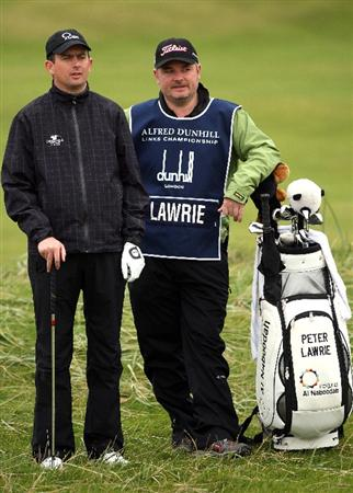 CARNOUSTIE, SCOTLAND - OCTOBER 02:  Peter Lawrie of Ireland waits with his caddie on the second hole during the second round of The Alfred Dunhill Links Championship at Carnoustie Golf Club on October 2, 2009 in Carnoustie, Scotland. (Photo by Andrew Redington/Getty Images  (Photo by Andrew Redington/Getty Images)