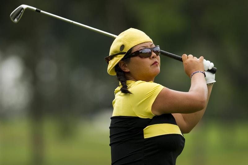CHON BURI, THAILAND - FEBRUARY 21:  Christina Kim of USA plays an approach shot to the 14th green during the final round of the Honda PTT LPGA Thailand at Siam Country Club on February 21, 2010 in Chon Buri, Thailand.  (Photo by Victor Fraile/Getty Images)