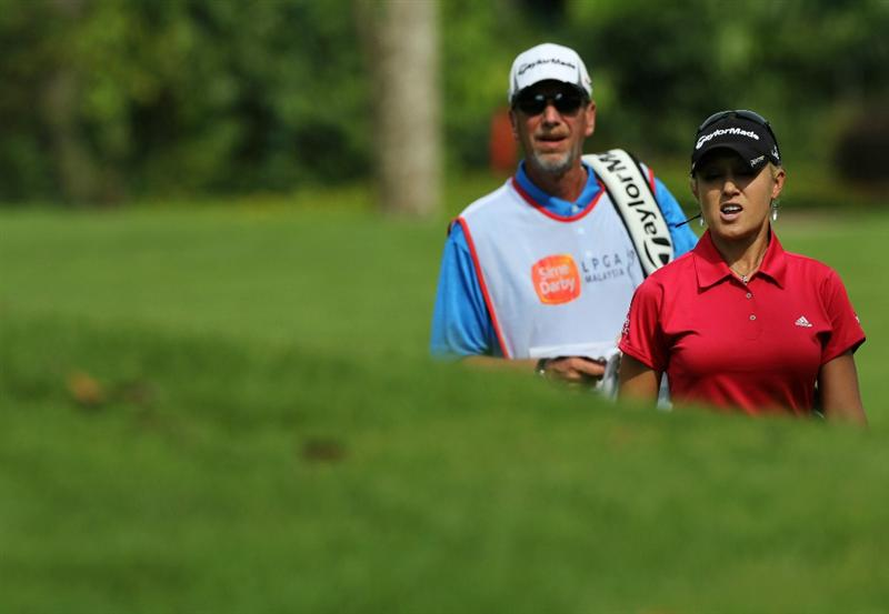 KUALA LUMPUR, MALAYSIA - OCTOBER 22:  Natalie Gulbis of USA discuss with her caddie on the bunker of the 1st hole during Round One of the Sime Darby LPGA on October 22, 2010 at the Kuala Lumpur Golf and Country Club in Kuala Lumpur, Malaysia. (Photo by Stanley Chou/Getty Images)