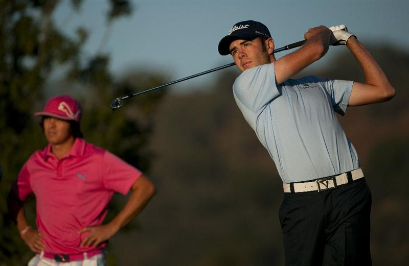 SAN MARTIN, CA - OCTOBER 14:  Troy Merritt makes a tee shot on the 11th hole as Rickie Fowler looks on during the first round of the Frys.com Open at the CordeValle Golf Club on October 14, 2010 in San Martin, California.  (Photo by Robert Laberge/Getty Images)
