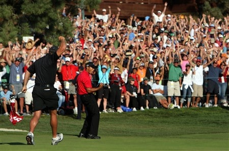 SAN DIEGO - JUNE 15:  Steve Williams runs towards Tiger Woods as he celebrates his birdie putt on the 18th green to force a playoff with Rocco Mediate during the final round of the 108th U.S. Open at the Torrey Pines Golf Course (South Course) on June 15, 2008 in San Diego, California.  (Photo by Donald Miralle/Getty Images)
