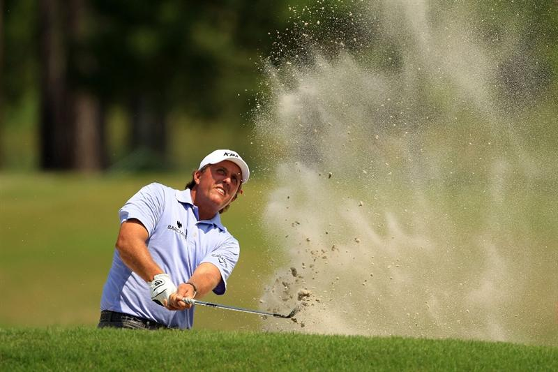 PONTE VEDRA BEACH, FL - MAY 13:  Phil Mickelson hits from a bunker on the fourth hole during the second round of THE PLAYERS Championship held at THE PLAYERS Stadium course at TPC Sawgrass on May 13, 2011 in Ponte Vedra Beach, Florida.  (Photo by Streeter Lecka/Getty Images)