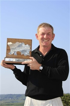 JERSEY, UNITED KINGDOM - JUNE 08: Tony Johnstone of Zimbabwe poses with the trophy after the final round of the Jersey Seniors Classic played at La Moye Golf Club on June 7, 2008 in St.Brelade, Jersey (Photo by Phil Inglis/Getty Images)