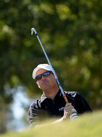 LAS VEGAS - OCTOBER 17:   Rich Beem tees off the 8th hole during the third round of the Justin Timberlake Shriners Hospitals for Children Open at the TPC Summerlin on October 17, 2009  in Las Vegas, Nevada. (Photo by Marc Feldman/Getty Images)