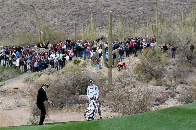 MARANA, AZ - FEBRUARY 26:  Bubba Watson chips to the 18th green in front of a gallery of fans during the semifinal round of the Accenture Match Play Championship at the Ritz-Carlton Golf Club on February 26, 2011 in Marana, Arizona.  (Photo by Sam Greenwood/Getty Images)