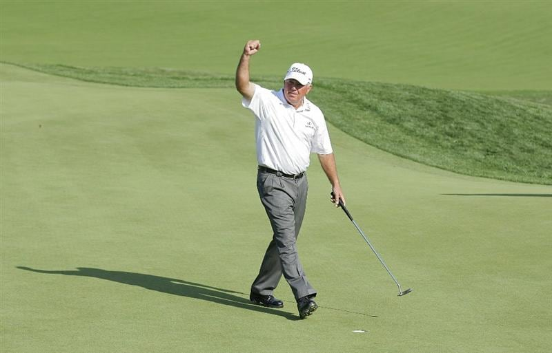 POTOMAC, MD - OCTOBER 10:  Mark O'Meara celebrates on the 18th green after winning the Constellation Energy Senior Players Championship in a one hole playoff at TPC Potomac at Avenel Farm on October 10, 2010 in Potomac, Maryland.  (Photo by Michael Cohen/Getty Images)