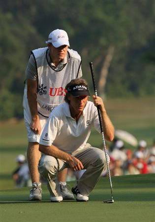 HONG KONG, CHINA - NOVEMBER 23:  Bernhard Langer of Germany and caddy son Stefan Langer line up his putt on the 14th hole during the final round of the UBS Hong Kong Open at the Hong Kong Golf Club on November 23, 2008 in Fanling, Hong Kong.  (Photo by Stuart Franklin/Getty Images)