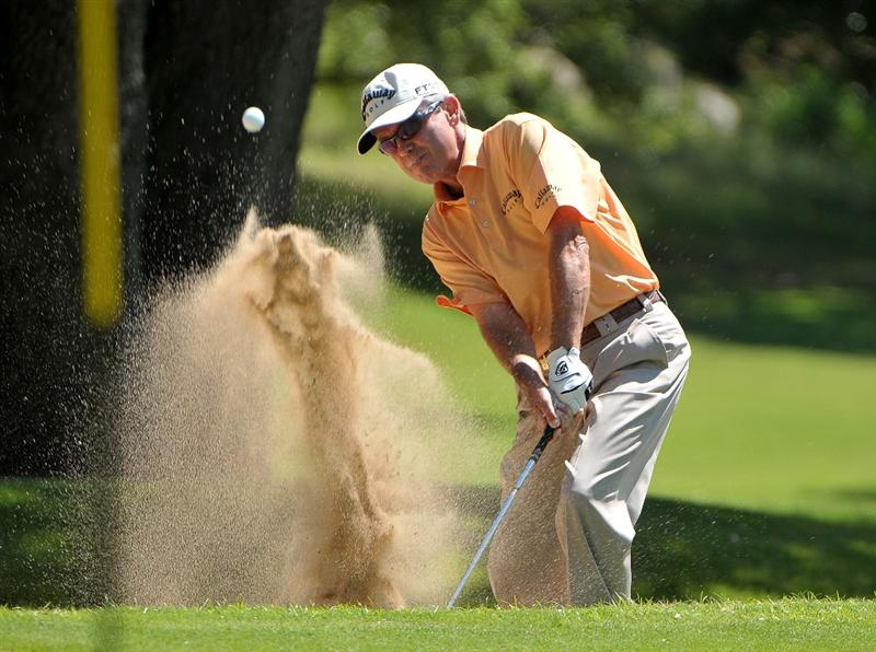 AUSTIN, TX - JUNE 05: Mark McNulty of Ireland  blasts out of the greenside bunker on the 3rd hole during the first round of the Triton Financial Classic  held at The Hills Country Club on June 5, 2009 in Austin, Texas. (Photo by Marc Feldman/Getty Images)