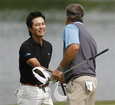 DULUTH, GA - MAY 18:  Ryuji Imada of Japan (L) shakes hands with Kenny Perry after defeating him in a playoff at the AT&T Classic at TPC Sugarloaf on May 18, 2008 in Duluth, Georgia.  (Photo by Matt Sullivan/Getty Images)