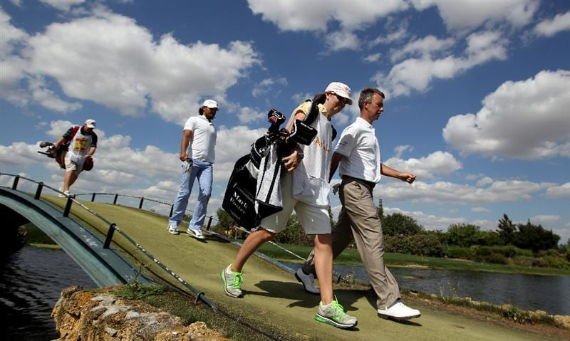 SEVILLE, SPAIN - MAY 01:  Mark Foster of England and his caddie Janet Squire make their way down the 18th fairway during the third round of the Open de Espana at the Real Club de Golf de Seville on May 1, 2010 in Seville, Spain.  (Photo by Ross Kinnaird/Getty Images)