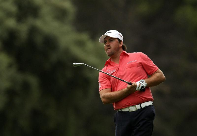 SOTOGRANDE, SPAIN - OCTOBER 30:  Graeme McDowell of Northern Ireland plays into the 16th green during the third round of the Andalucia Valderrama Masters at Club de Golf Valderrama on October 30, 2010 in Sotogrande, Spain.  (Photo by Richard Heathcote/Getty Images)