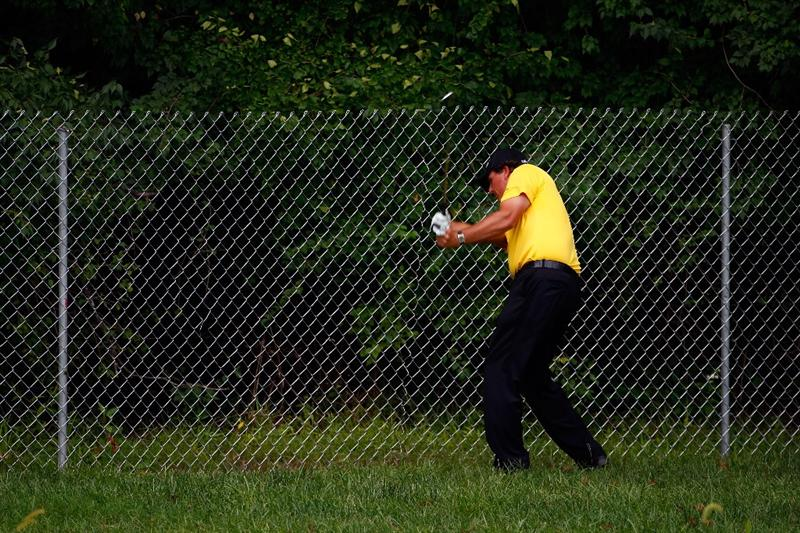 ST. LOUIS - SEPTEMBER 06:  Phil Mickelson hits his second shot on the 17th hole right-handed as his ball lay up against a fence during the third round of the BMW Championship on September 6, 2008 at Bellerive Country Club in St. Louis, Missouri.  (Photo by Jamie Squire/Getty Images)