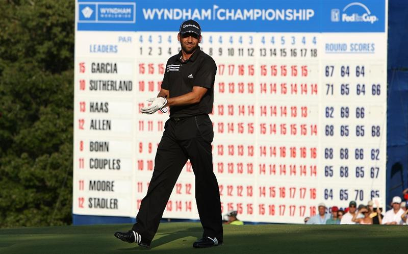 GREENSBORO, NC - AUGUST 23:  Sergio Garcia of Spain walks in front of the leaderboard on the 18th green during the final round of the Wyndham Championship at Sedgefield Country Club on August 23, 2009 in Greensboro, North Carolina.  (Photo by Streeter Lecka/Getty Images)