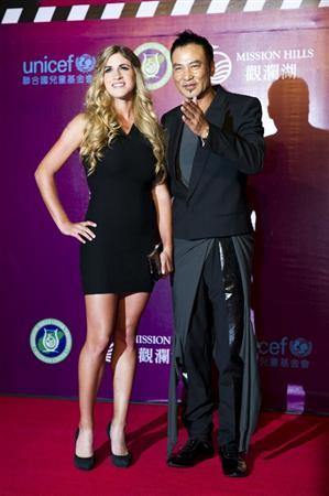 HAIKOU, CHINA - OCTOBER 29:  Spanish golfer Belen Mozo (L) and Hong Kong actor Simon Yam attend red carpet during day three of the Mission Hills Start Trophy tournament at Mission Hills Resort on October 29, 2010 in Haikou, China.  (Photo by Victor Fraile/Getty Images for Mission Hills)