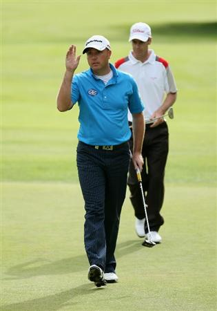 CRANS, SWITZERLAND - SEPTEMBER 02:  Graeme Storm of England acknowledges the crowd on the ninth green during the first round of The Omega European Masters at Crans-Sur-Sierre Golf Club on September 2, 2010 in Crans Montana, Switzerland.  (Photo by Warren Little/Getty Images)