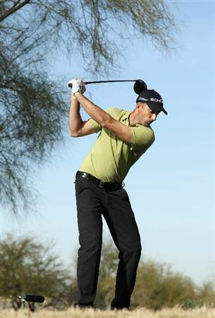 SCOTTSDALE, AZ - FEBRUARY 06:  Geoff Ogilvy of Australia hits a tee shot on the 13th hole during the third round of the Waste Management Phoenix Open at TPC Scottsdale on February 6, 2011 in Scottsdale, Arizona.  (Photo by Christian Petersen/Getty Images)