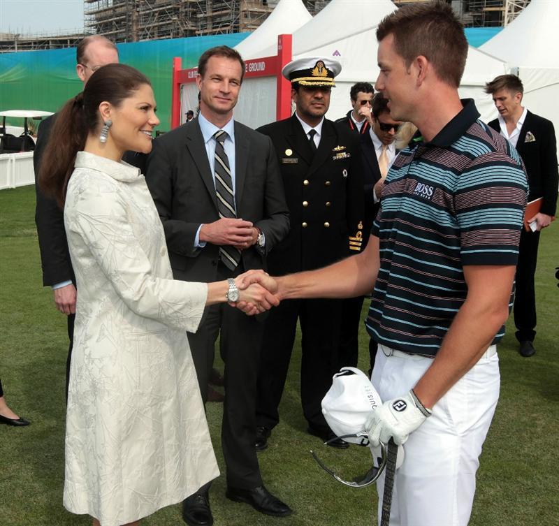 ABU DHABI, UNITED ARAB EMIRATES - JANUARY 20:  Princess Victoria of Sweden accompanied by the Swedish Ambassador to The UAE Mr Magnus Scholdtz (beside the princess) meet star professional golfer Henrik Stenson of Sweden before he teed off in the first round of the 2011 Abu Dhabi HSBC Golf Championship to be held at the Abu Dhabi Golf Club on January 20, 2011 in Abu Dhabi, United Arab Emirates.  (Photo by David Cannon/Getty Images)