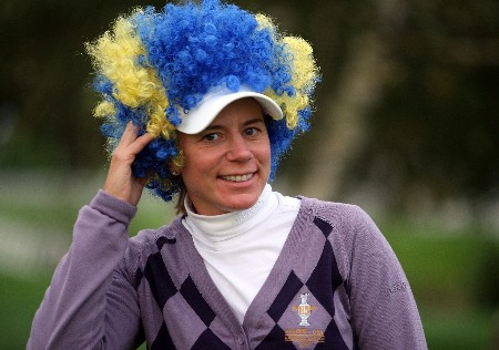 HALMSTAD, SWEDEN - SEPTEMBER 16: Annika Sorenstam of The European Team poses with the wig that she wore during the closing ceremony of the Solheim Cup at Halmstad Golf Club September 16, 2007 in Halmstad, Sweden.  The USA won the 16-12. (Photo by Andy Lyons/Getty Images)