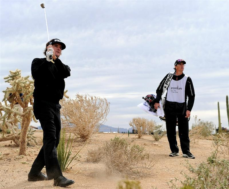 MARANA, AZ - FEBRUARY 26:  Bubba Watson watches his approach shot on the first playoff hole against J.B. Holmes during the quarterfinal round of the Accenture Match Play Championship at the Ritz-Carlton Golf Club on February 26, 2011 in Marana, Arizona.  (Photo by Stuart Franklin/Getty Images)
