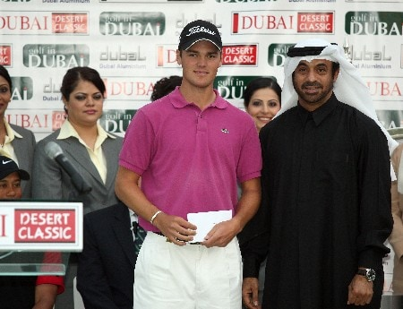 DUBAI, UNITED ARAB EMIRATES - FEBRUARY 3: Martin Kaymer of Germany receives his second prize cheque after the final round of the Dubai Desert Classic, on the Majilis Course at the Emirates Golf Club, on February 3, 2008 in Dubai, United Arab Emirates.  (Photo by David Cannon/Getty Images)