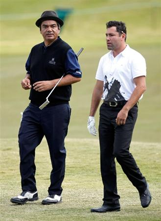 LAS VEGAS - OCTOBER 14:  Actor/comedian George Lopez (L) and boxing promoter Oscar De La Hoya walk up the 9th fairway during the Justin Timberlake Shriners Hospitals for Children Open Championship Pro-Am at the TPC Summerlin October 14, 2009 in Las Vegas, Nevada.  (Photo by Ethan Miller/Getty Images)