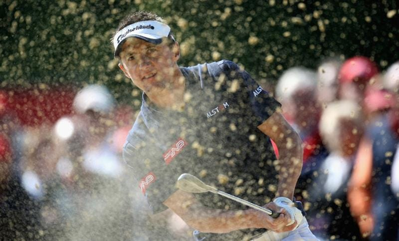 CRANS, SWITZERLAND - SEPTEMBER 07:  Jean-Francois Lucquin of France plays third shot on the par five 15th hole during the final round of the Omega European Masters at the Golf Club Crans-sur-Sierre on September 7, 2008 in Crans, Switzerland.  (Photo by Ross Kinnaird/Getty Images)