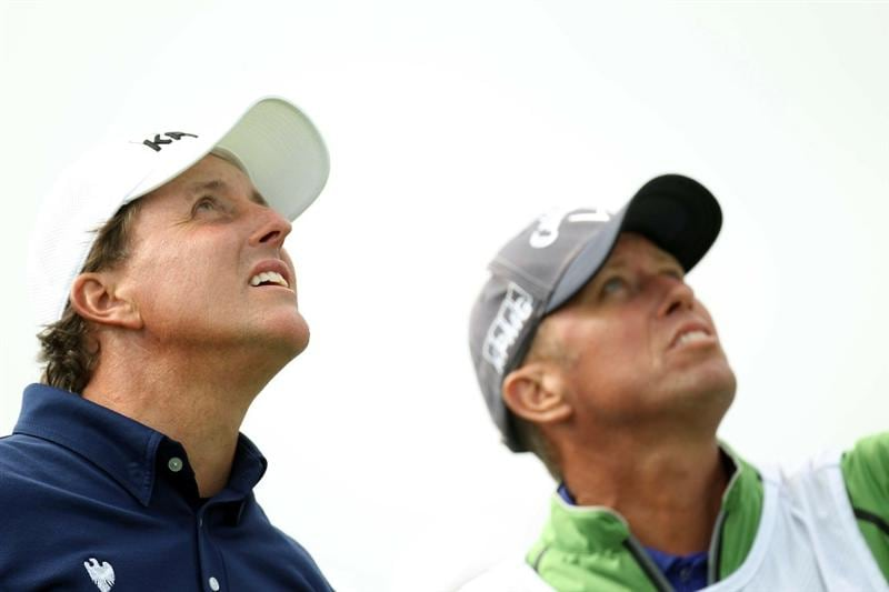 PEBBLE BEACH, CA - JUNE 19:  Phil Mickelson and his caddie Jim 'Bones' MacKay look up during the third round of the 110th U.S. Open at Pebble Beach Golf Links on June 19, 2010 in Pebble Beach, California.  (Photo by Ross Kinnaird/Getty Images)