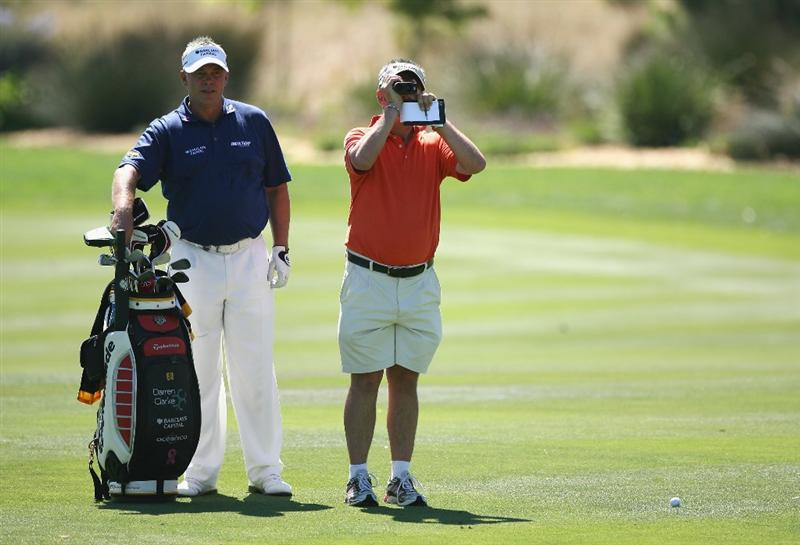 PAARL, SOUTH AFRICA - DECEMBER 16:  Darren Clarke of Northern Ireland gets the correct yardage from his caddie for his approach shot on the fifth hole during practice before the South African Open Championship at Pearl Valley Golf Club on December 16, 2008 in Paarl, South Africa.  (Photo by Warren Little/Getty Images)
