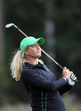 CALGARY, AB - SEPTEMBER 05 : Suzann Pettersen of Norway watches her third shot on the ninth hole during the third round of the Canadian Women's Open at Priddis Greens Golf & Country Club on September 5, 2009 in Calgary, Alberta, Canada. (Photo by Hunter Martin/Getty Images)
