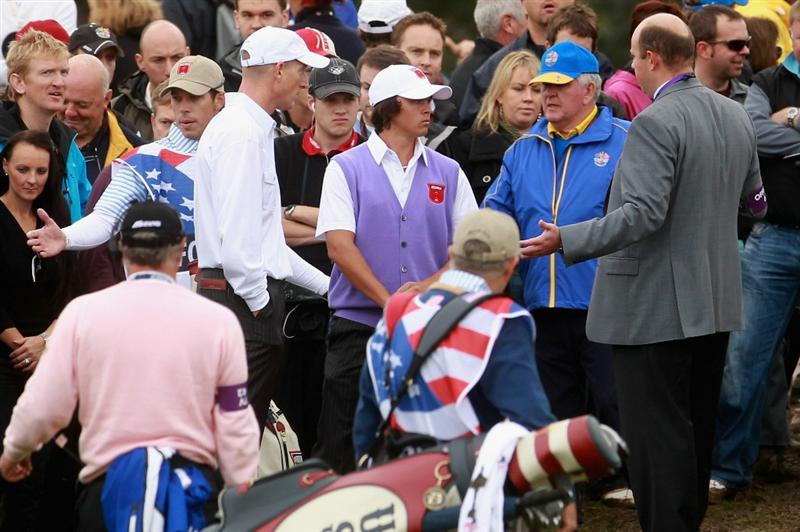 NEWPORT, WALES - OCTOBER 02:  Jim Furyk (L) and his playing partner Rickie Fowler chat with rules official Simon Higginbottom after Fowler dropped the wrong type of golf ball on the fourth hole and cost them the hole during the rescheduled Afternoon Foursome Matches during the 2010 Ryder Cup at the Celtic Manor Resort on October 2, 2010 in Newport, Wales.  (Photo by Andrew Redington/Getty Images)