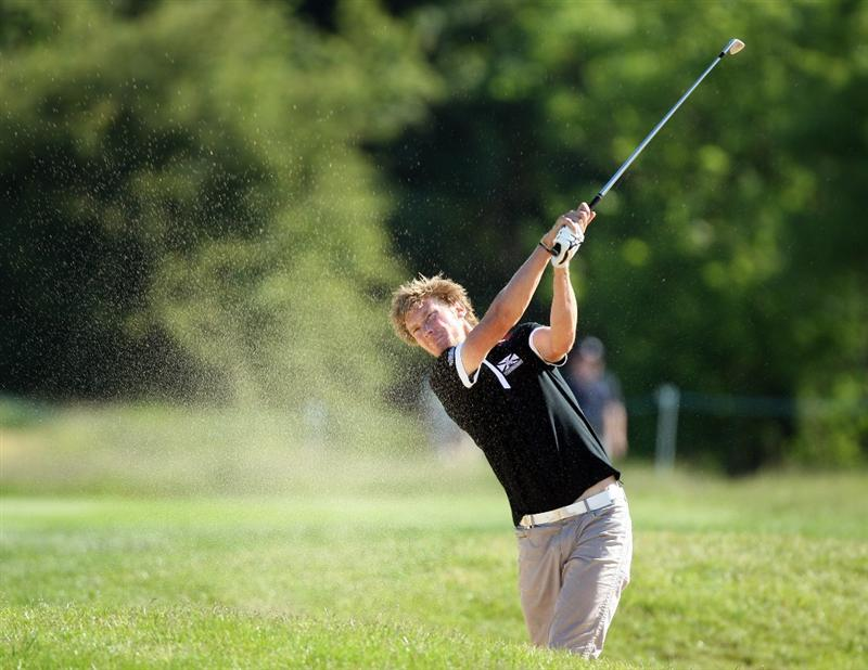 ASH, UNITED KINGDOM - MAY 31:  Chris Wood of England hits his second shot at the 16th hole during the final round of the 2009 European Open at the London Golf Club on May 31, 2009 in Ash, England.  (Photo by David Cannon/Getty Images)