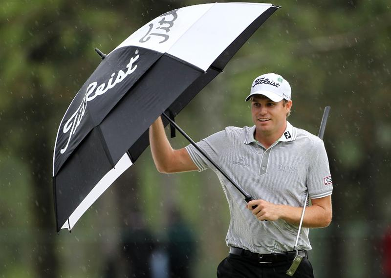 AUGUSTA, GA - APRIL 08:  Nick Watney walks under an umbrella to the 17th green during the first round of the 2010 Masters Tournament at Augusta National Golf Club on April 8, 2010 in Augusta, Georgia.  (Photo by Jamie Squire/Getty Images)
