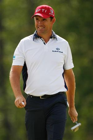 HUMBLE, TX - APRIL 04:  Padraig Harrington reacts after making a putt for par on the 8th hole during a continuation of the second round of the Shell Houston Open at Redstone Golf Club April 4, 2009 in Humble, Texas.  (Photo by Chris Graythen/Getty Images)