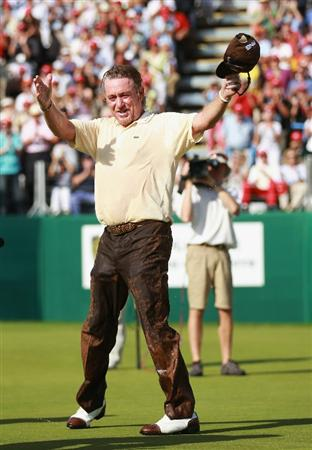 CRANS, SWITZERLAND - SEPTEMBER 05:  Miguel Angel Jimenez of Spain blow a kiss the crowd after being pushed into the water by the 18th green by fellow Spanish players Pablo Larrazabal and Pablo Martin after winning The Omega European Masters on a score of -21 under par at Crans-Sur-Sierre Golf Club on September 5, 2010 in Crans Montana, Switzerland.  (Photo by Warren Little/Getty Images)
