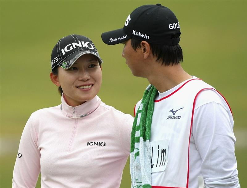 SHIMA, JAPAN - NOVEMBER 07:  Eun-A Lim of South Korea look on with caddie on the 17th hole during the first round of 2008 Mizuno Classic at Kintetsu Kashikojima Country Club on November 7, 2008 in Shima, Mie, Japan.  (Photo by Koichi Kamoshida/Getty Images)