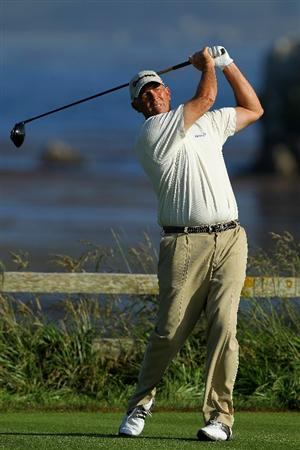 PEBBLE BEACH, CA - JUNE 17:  Tom Lehman hits a tee shot on the 18th hole during the first round of the 110th U.S. Open at Pebble Beach Golf Links on June 17, 2010 in Pebble Beach, California.  (Photo by Donald Miralle/Getty Images)