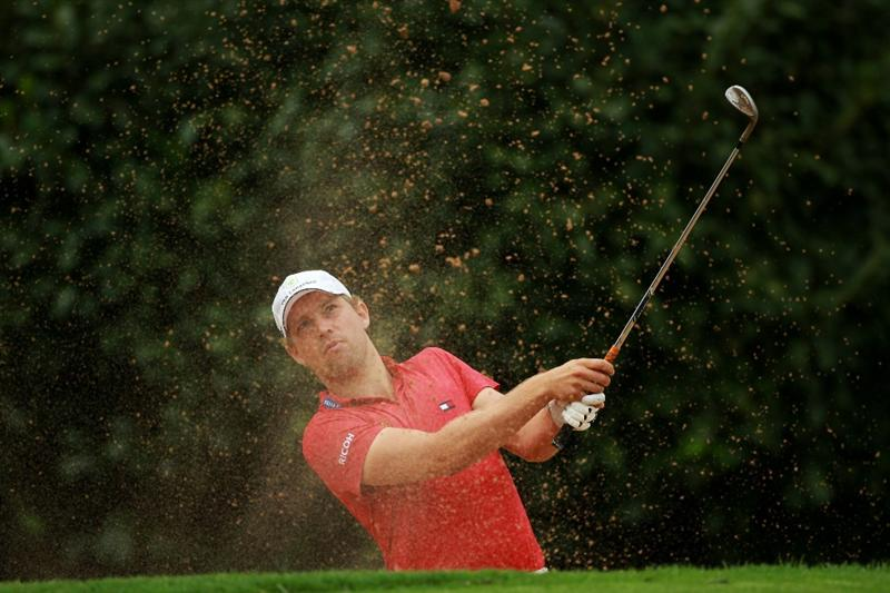 JOHANNESBURG, SOUTH AFRICA - JANUARY 20:  Floris de Vries of the Netherlands plays out of the first greenside bunker during the second round of The 2011 Open Championship, International Final Qualifying Africa at Royal Johannesburg & Kensington Golf Club on January 20, 2011 in Johannesburg, South Africa.  (Photo by Warren Little/Getty Images)