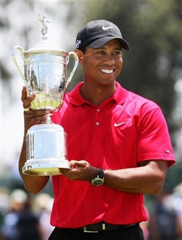 SAN DIEGO - JUNE 16:  Tiger Woods celebrates with the trophy after winning on the first sudden death playoff hole during the playoff round of the 108th U.S. Open at the Torrey Pines Golf Course (South Course) on June 16, 2008 in San Diego, California.  (Photo by Ross Kinnaird/Getty Images)