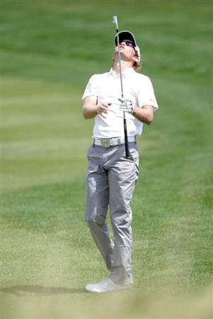 OVERLAND PARK, KS - AUGUST 21:  Michael Sim of Australia reacts after hitting his second shot on the 9th hole during the second round of the Nationwide Christmas in October Classic on August 21, 2009 at Lions Gate Golf Club in Overland Park, Kansas.  (Photo by Jamie Squire/Getty Images)