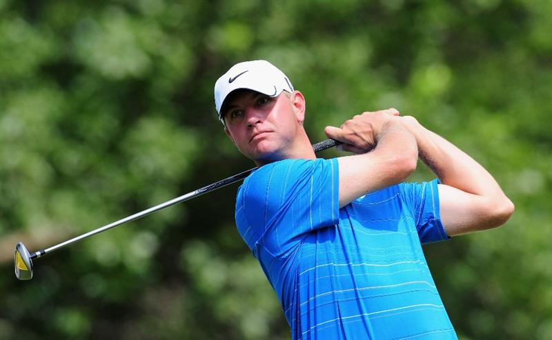 AKRON, OH - AUGUST 06:  Lucas Glover of USA plays his tee shot on the 14th hole during the first round of the World Golf Championship Bridgestone Invitational on August 6, 2009 at Firestone Country Club in Akron, Ohio.  (Photo by Stuart Franklin/Getty Images)