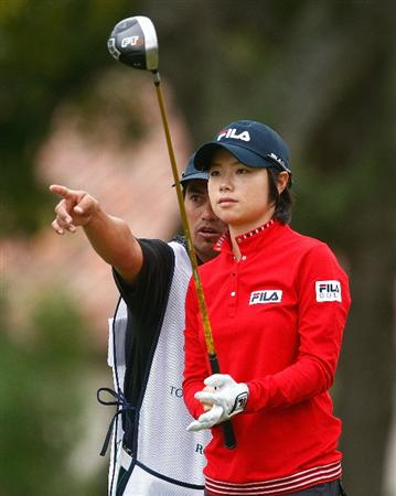 RICHMOND, TX - NOVEMBER 20:  Eun-Hee Ji of South Korea chats with her caddie Zac Austin on the first tee during the second round of the LPGA Tour Championship presented by Rolex at the Houstonian Golf and Country Club on November 20, 2009 in Richmond, Texas.  (Photo by Scott Halleran/Getty Images)