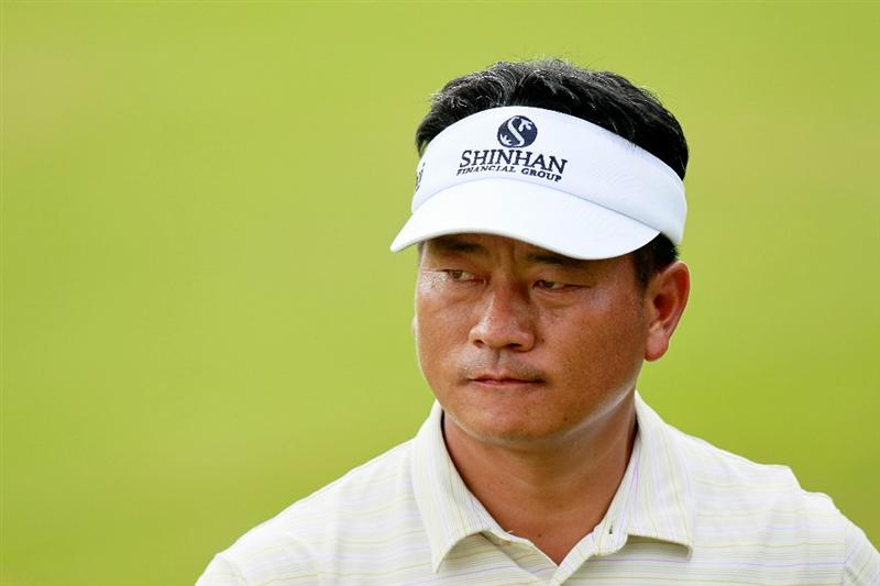 ATLANTA - SEPTEMBER 24:  K.J. Choi of South Korea looks on from the ninth hole during the second round of THE TOUR Championship presented by Coca-Cola at East Lake Golf Club on September 24, 2010 in Atlanta, Georgia.  (Photo by Kevin C. Cox/Getty Images)