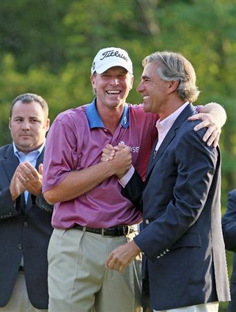 NORTON, MA - SEPTEMBER 7:  Steve Stricker laughs with Seth Waugh, CEO of Deutsche Bank America, after Stricker won the the Deutsche Bank Championship held at TPC Boston on September 7, 2009 in Norton, Massachusetts. (Photo by Jim Rogash/Getty Images)