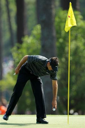 AUGUSTA, GA - APRIL 10:  Charl Schwartzel of South Africa takes his golf ball from the hole after holing a shot for eagle on the third green during the final round of the 2011 Masters Tournament on April 10, 2011 in Augusta, Georgia.  (Photo by Jamie Squire/Getty Images)