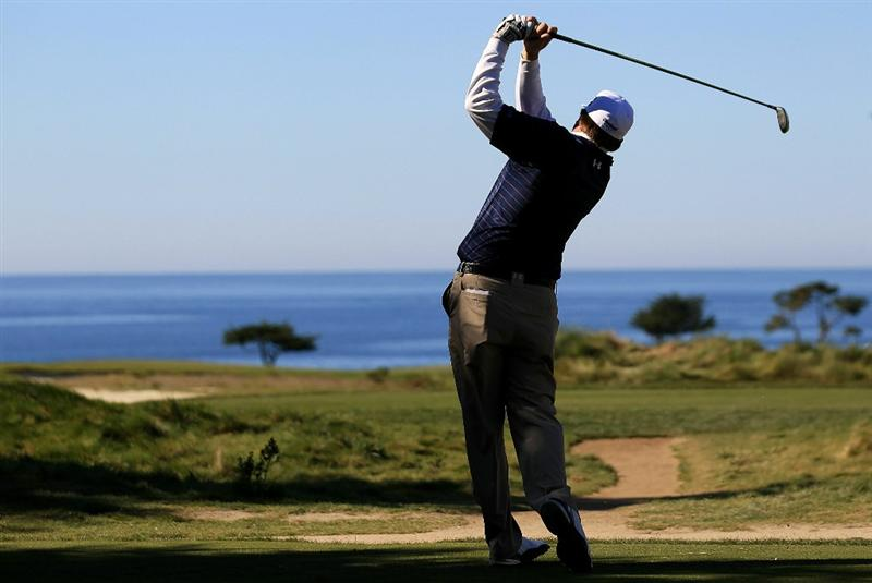 PEBBLE BEACH, CA - FEBRUARY 12:  Steve Marino tees off from the fifth hole at the AT&T Pebble Beach National Pro-Am- Round Three at the Monterey Peninsula country club on February 12, 2011 in Pebble Beach, California.  (Photo by Jed Jacobsohn/Getty Images)