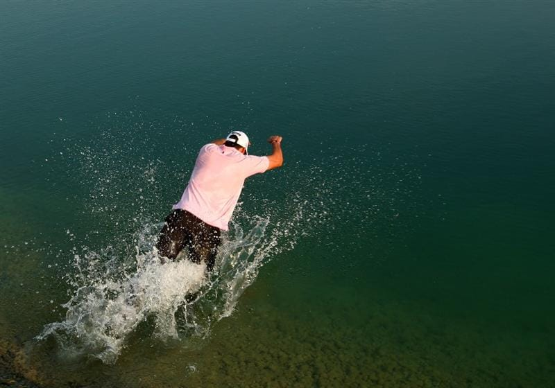 VIENNA, AUSTRIA - SEPTEMBER 20:  Rafael Cabrera-Bello of Spain takes a celebratory swim in the lake after his 1 shot victory during the fourth round of the Austrian Golf Open at Fontana Golf Club on September 20, 2009 in Vienna, Austria.  (Photo by Richard Heathcote/Getty Images)