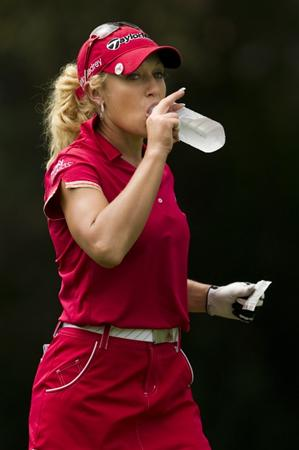 CHON BURI, THAILAND - FEBRUARY 20:  Natalie Gulbis of USA drinks on the 9th hole during round three of the Honda PTT LPGA Thailand at Siam Country Club on February 20, 2010 in Chon Buri, Thailand.  (Photo by Victor Fraile/Getty Images)