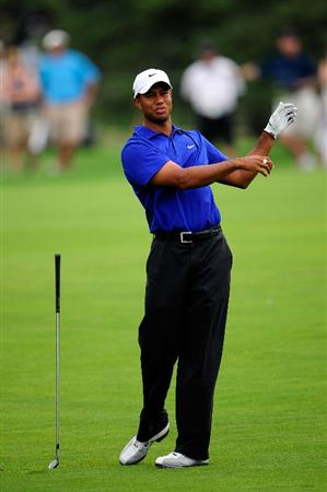 CHASKA, MN - AUGUST 15:  Tiger Woods reacts to a poor shot on the fifth hole during the third round of the 91st PGA Championship at Hazeltine National Golf Club on August 15, 2009 in Chaska, Minnesota.  (Photo by Sam Greenwood/Getty Images)