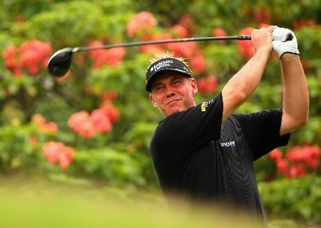 KUALA LUMPUR, MALAYSIA - MARCH 07:  Darren Clarke of Northern Ireland tees off on the seventh hole during the second round of the Maybank Malaysian Open held at the Kota Permai Golf & Country Club on March 7, 2008 in Kuala Lumpur, Malaysia.  (Photo by Andrew Redington/Getty Images)